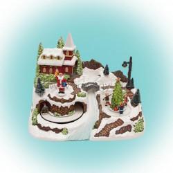 Világító karácsonyi falu, mozgó szánnal, mikulással gyermekekkel